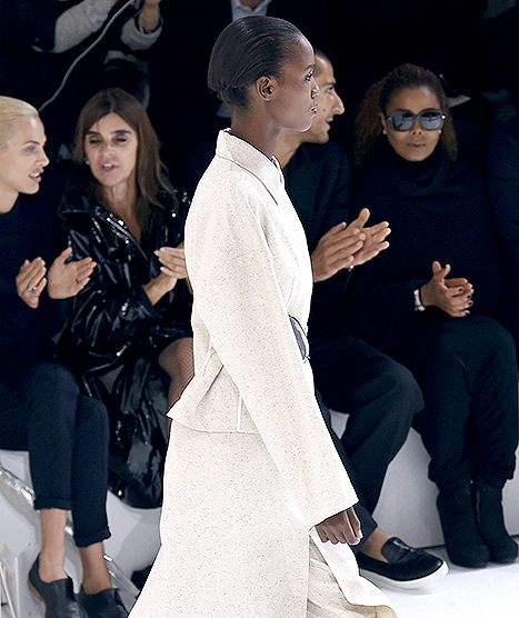 French model Aymeline Valade (L), French fashion editor Carine Roitfeld (2R), US singer Janet Jackson (R) and husband Wissam Al Mana (C) watch a model presenting Hermes 2016 Spring/Summer ready-to-wear collection fashion show, on October 5, 2015 in Paris.
