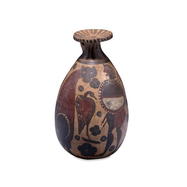 Pottery perfume bottle (alabastron), attributed to the Pescia Romana Painter. Etrusco-Corinthian, 590-580 BC  Probably made in Vulci, ancient Etruria (now in Lazio, Italy)    Decorated with a figure of a warrior