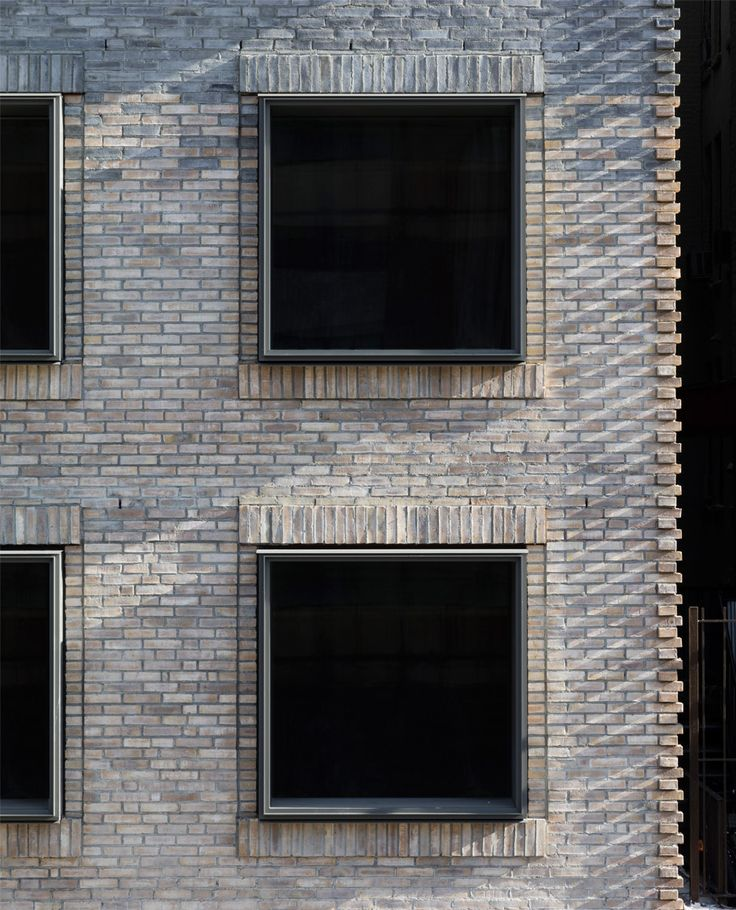 "Multi-tonal brick facade of New York City apartment block references neighbourhood's ""gritty"" past"