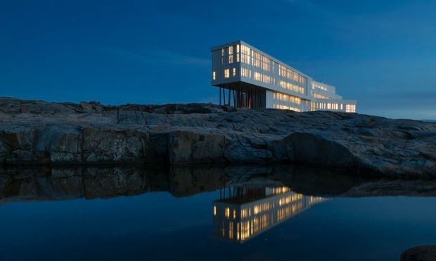"Surrounded by Newfoundland, Canada's minimal yet dramatic landscape, the Fogo Island Inn was the brainchild of former tech-exec Zita Cobb. The luxury 29 room hotel was designed by architect Todd Saunders and includes an art gallery, heritage library, cinema and rooftop sauna. <a href=""http://www.fogoislandinn.ca/"">fogoislandinn.ca</a>"