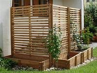Planters on outside fence for trailing plants to grow... More coverage. #privacy