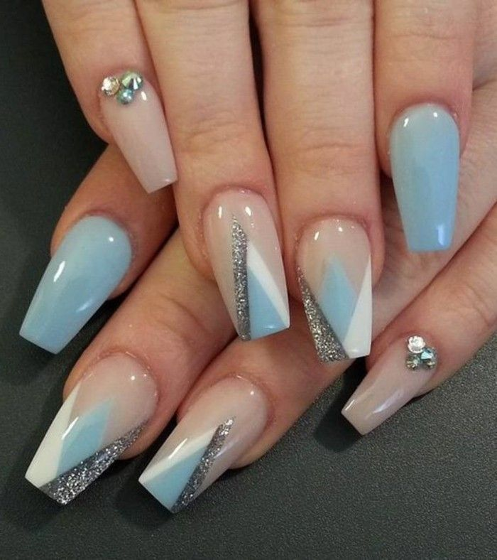 pastel blue and pastel pink nails, decorated with rhinestones, white and silver details