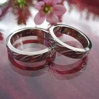 """Together we rock!"" Wedding rings in 14K white gold, made by jewellerydesigner Ailin Roelvaag. The pattern consists of two pointy hearts weaved together celtic style."