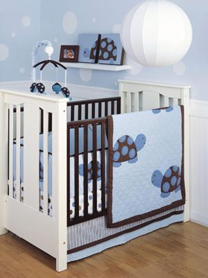 if it's a boy, i bet i can find turtle or other cartoony reptile print for the bed to match the mint green.  I like this photo because of the white crib.
