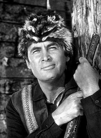Fess Parker - Daniel Boone | Daniel Boone was a man, Yes, a big man! With an eye like an eagle and as tall as a mountain was he! Daniel Boone was a man, Yes, a big man! He was brave, he was fearless and as tough as a mighty oak tree! From the coonskin cap on the top of ol' Dan To the heel of his rawhide shoe; The rippin'est, roarin'est, fightin'est man The frontier ever knew!
