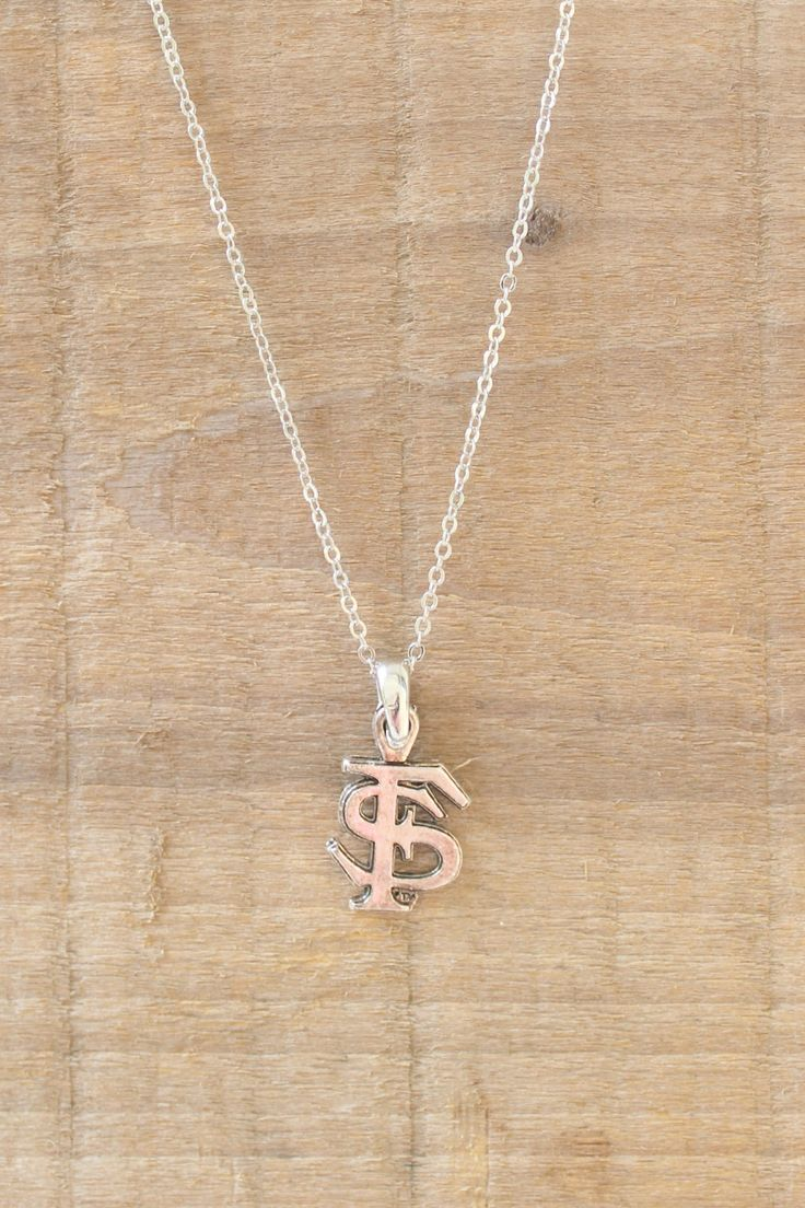 This Florida State University necklace is great for tailgating in Tallahassee or rooting for the 'Noles at home! Burnished pewter logo on a silver link chain.