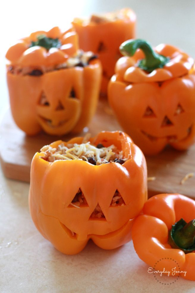 Stuffed peppers with shredded chicken, black beans and Mexican rice. Great for a Halloween dinner. Recipe at http://everydayjenny.com
