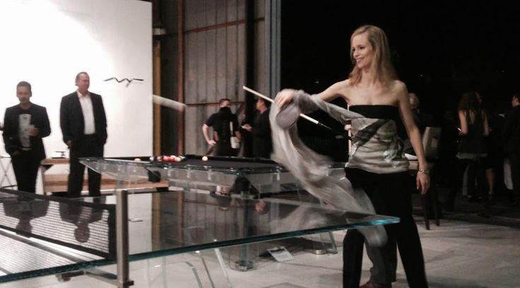Luxury is not only a state of mind!  Beautiful and elegant woman playing ping pong on LUNGOLINEA's crystal.  #pingpong #tennisTable #gameTable #luxuryFurniture #crystal #table #design #madeInItaly