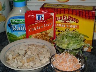 Do You Smell That!!?: Chicken Ranch Tacos ... crock pot method: use 2lbs of raw (not frozen) chicken breast, 1 packet of dry ranch dressing, 1 packet chicken taco seasoning & 1 can of chicken broth. Put that all in the crockpot and cooked on low for 3 hours then shredded the chicken and let it cook on low another 30 min. Last 10 min of cooking.  Heat low carb tortillas and mix diced tomatoes, a bag mix of salad, shredded cheddar cheese and a little bottled ranch together for topping.