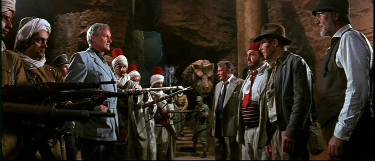 "Walter Donovan (Julian Glover), Dr. Marcus Brody (Denholm Elliot), Sallah (John Rhys-Davies), Henry ""Indiana"" Jones Jr. (Harrison Ford), & Henry Jones Sr. (Sean Connery) - Indiana Jones and the Last Crusade (1989)"