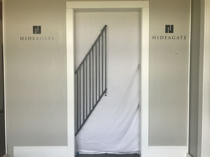 Durable and fashionable dog gate for luxury homes that tucks in the wall when not in use. Custom home ideas for a functional space.