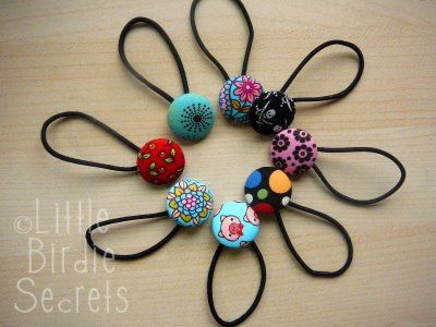 covered button hair ties  - put elastic through the metal loop on the back of the button