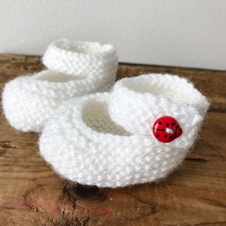 Mary Jane Knit Baby Booties, white | knit baby booties, baby shower gifts, baby decor, knit baby shoes, knit baby gifts, white baby booties by 701knits on Etsy https://www.etsy.com/listing/517359305/mary-jane-knit-baby-booties-white-knit
