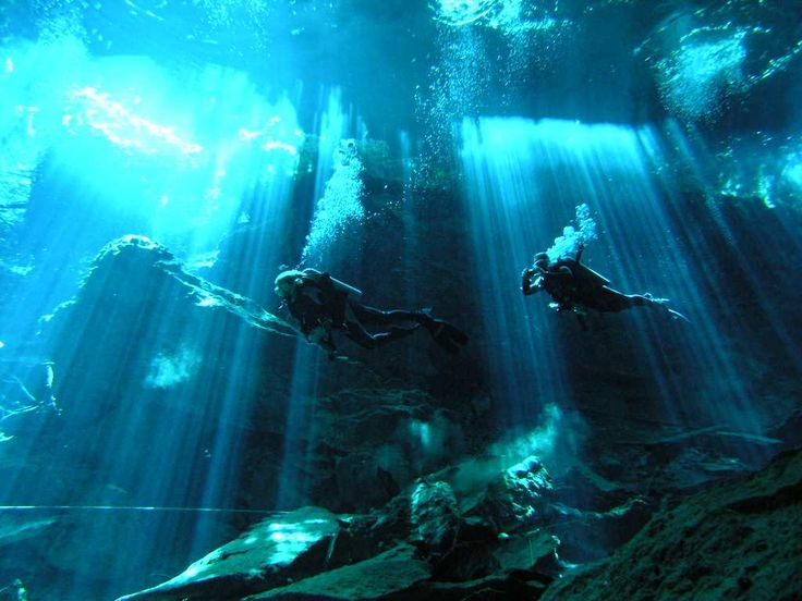 """Photos of Cenotes -A cenote is a deep natural pit, or sinkhole, characteristic of Mexico, resulting from the collapse of limestone bedrock that exposes groundwater underneath. Especially associated with the Yucatán Peninsula and some nearby Caribbean islands, cenotes were sometimes used by the ancient Maya for sacrificial offerings. The term derives from a word used by the low-land Yucatec Maya, """"Ts'onot"""" to refer to any location with accessible groundwater."""