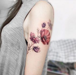 Elegant florals on arm by Tattooist Flower