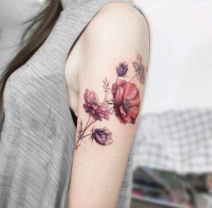 Elegant florals on arm by Tattooist Flower
