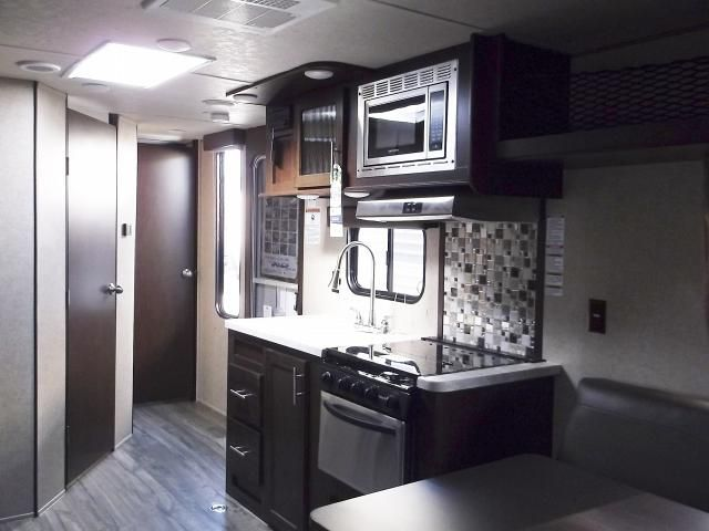 2017 Grey Wolf 22RR - Light Weight Toy Hauler Travel Trailer Grey Wolf 22RR toy hauler trailer features a front bedroom with a Queen size bed with hanging wardrobes on either side. There is also under bed storage. There are 2 doors in the bedroom, one leading to bathroom and the other to the main living area.