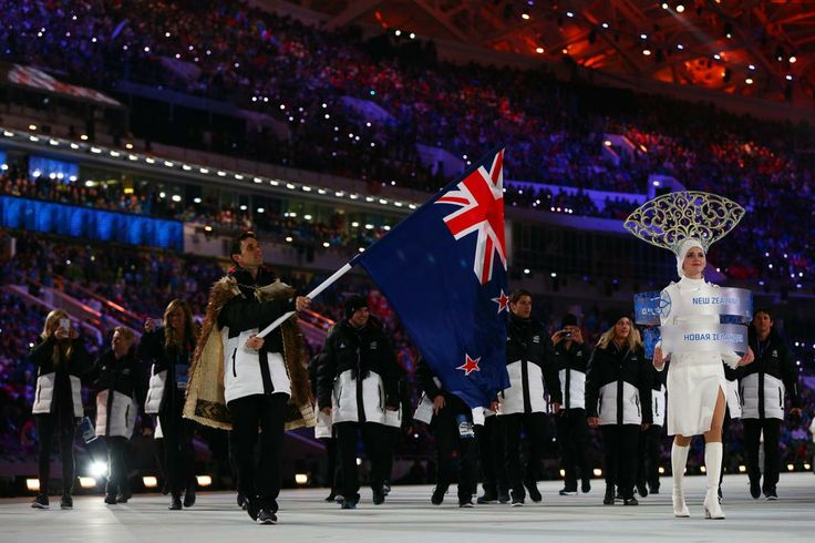 Snowboarder Alex Pullin of the Australia Olympic team carries his country's flag during the Opening Ceremony of the Sochi 2014 Winter Olympi...