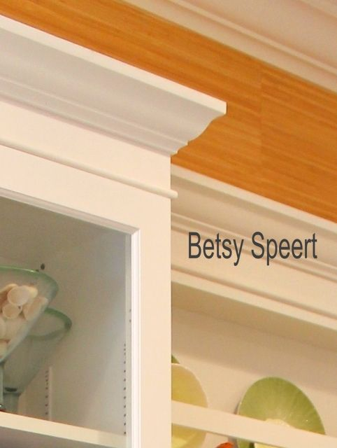 crown molding,the half round covers seam between cabinet top and additional board