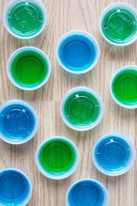 Berry blue Jello and lime Jello with Malibu rum from tryanythingonceculinary.com make delicious blue and green Jello shots to cheer on our favorite Seattle football team!