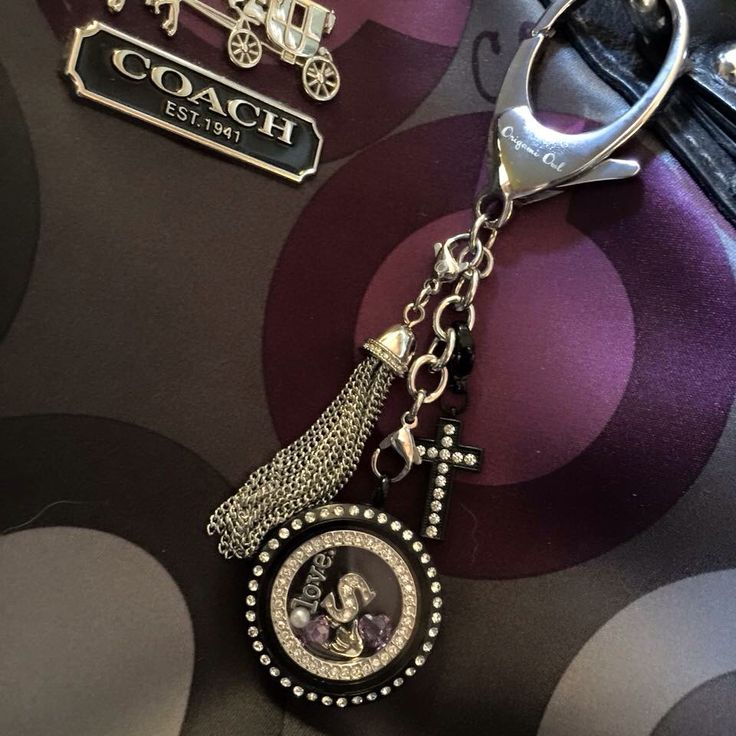 Origami Owl Bag Clip + Keychain  Take your favorite O2 Locket and adorn your favorite Satchel with this new Bag Clip!