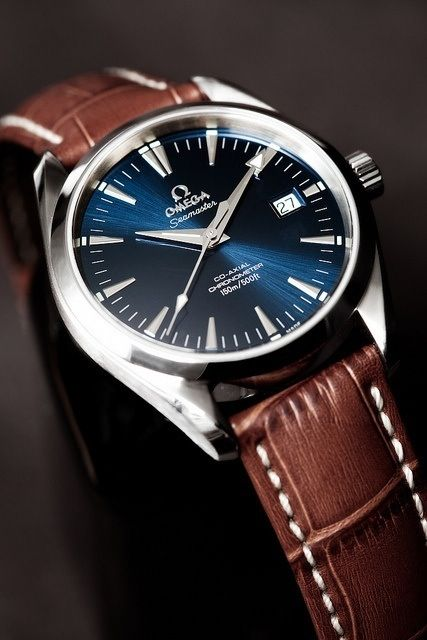 Omega Mens Watch  Pinned because Tim wants a blue faced watch with brown leather strap.