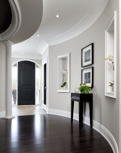 Gray walls, white trim, dark hardwood floors, Black furniture