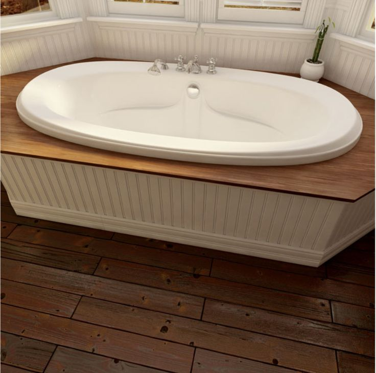 Traditional Style Oval Podium Bathtub By Produits Neptune / Félicia  Collection