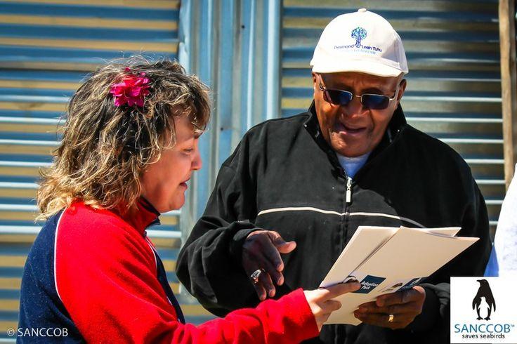 ArchBishop Desmond Tutu and Executive Director of SANCCOB Margaret Roestorf