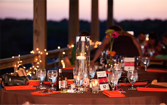 Orange, pink and brown wedding decor at the Wild Horse event home. Kristi Midgette Photographyhttp://www.outerbanksweddingassoc.org/membersearch/memberpage.html?MID=1880=Photographers=16 #obxwedding #wildhorse #obxeventhome