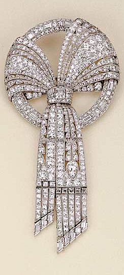 AN ART DECO PLATINUM AND DIAMOND BOW BROOCH, BY HARVEY & GORE LONDON. //// This looks like a diamond waterfall.