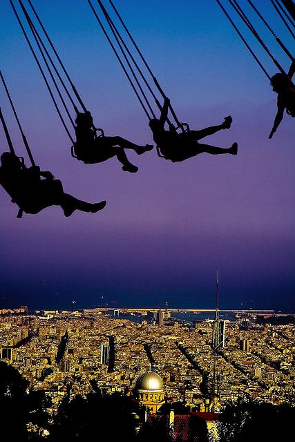 Swings at Tibidabo mountain - Barcelona, Spain. MAYBE one day I will be able to say I did this!