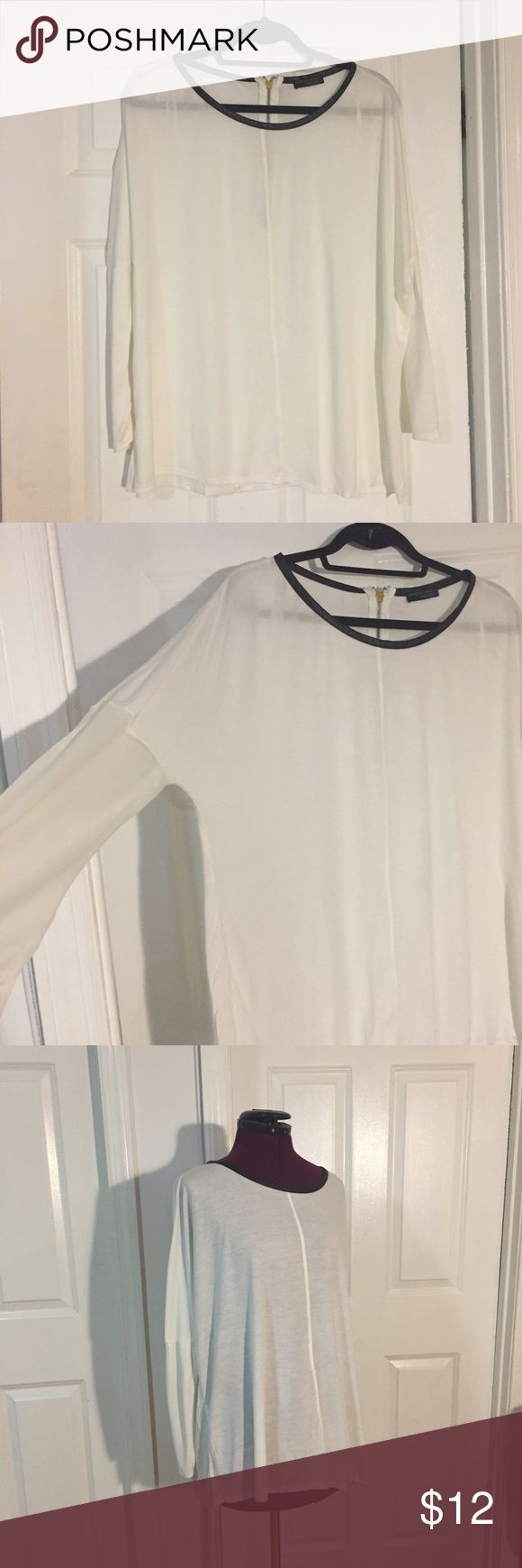 ZARA T-shirt batwing top with faux leather trim Great Condition - barely worn  Drapey cut, arms are cut tight at bottom  faux leather contrast details at back zip and around the neckline gold zipper  Smoke Free Household Zara Tops Tunics