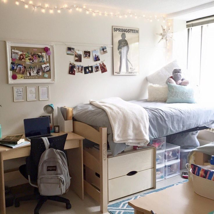I like the orientation of the beds & desk! I also like the under the bed storage bins & semetrical look of the things hung on the wall. Symmetrical