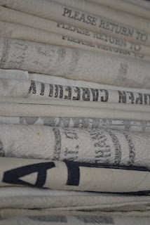piles of vintage farm bags