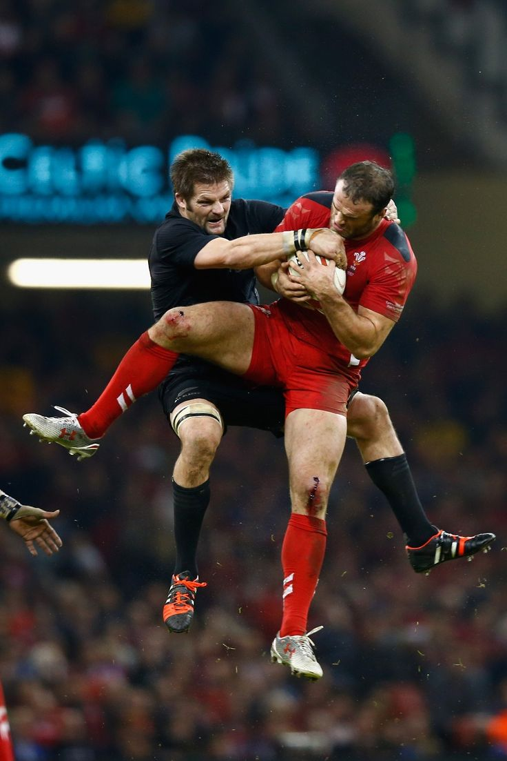 Richie McCaw and Jamie Roberts do battle in the air