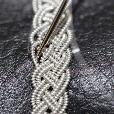 sami bracelet - braided strands then attached to leather.   ~ Seed Bead Tutorials