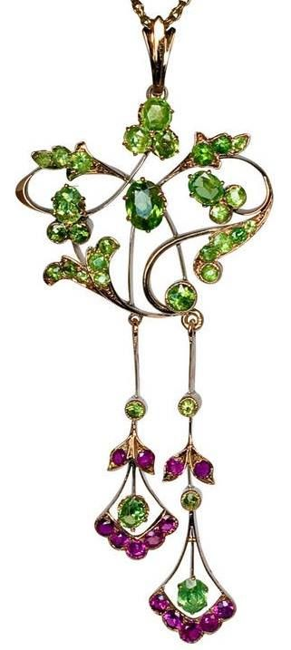 Art Nouveau Russian Demantoid Ruby Pendant, made in Moscow between 1908 and 1917. A 14K gold pendant of an openwork floral design set with Russian Uralian demantoids and natural rubies, marked on frame with 56 zolotnik gold standard, maker's initials and later Soviet control mark for 583 gold from the 1930s.