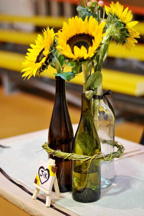 Love this! Might paint the bottles to match our colors, but the sunflowers are beautiful!!