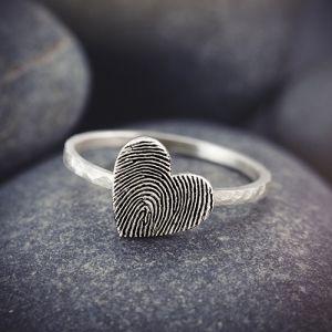 Fingerprint on heart ring