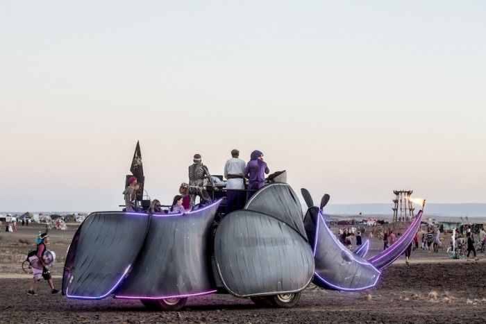 The rhino art car was one of the moving parties, playing music in the desert.