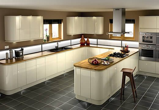 Sofia Kitchen.The clean lines and minimalist design of Sofia produce a look that is beautiful in its simplicity. A high gloss cream finish with gorgeous inverse curves on the base and wall units.