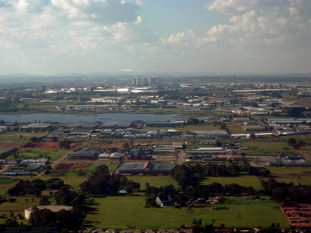 Industrial area east of Johannesburg. Originally I thought it might be Soweto and the Orlando power station, but now I realize that would be way too far off the flight path... and the station doesn't look right anyway. Thanks to thatomkn, I investiga  - Awesome South Africa. Think about Immigration to South Africa