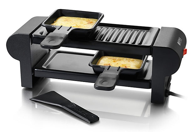 Mini Raclette Machine (Romantic racletting for two: This mini raclette features two tiers for grilling and melting cheese, allowing for endless possibilities when it comes to dinner preparation.)    $35.00