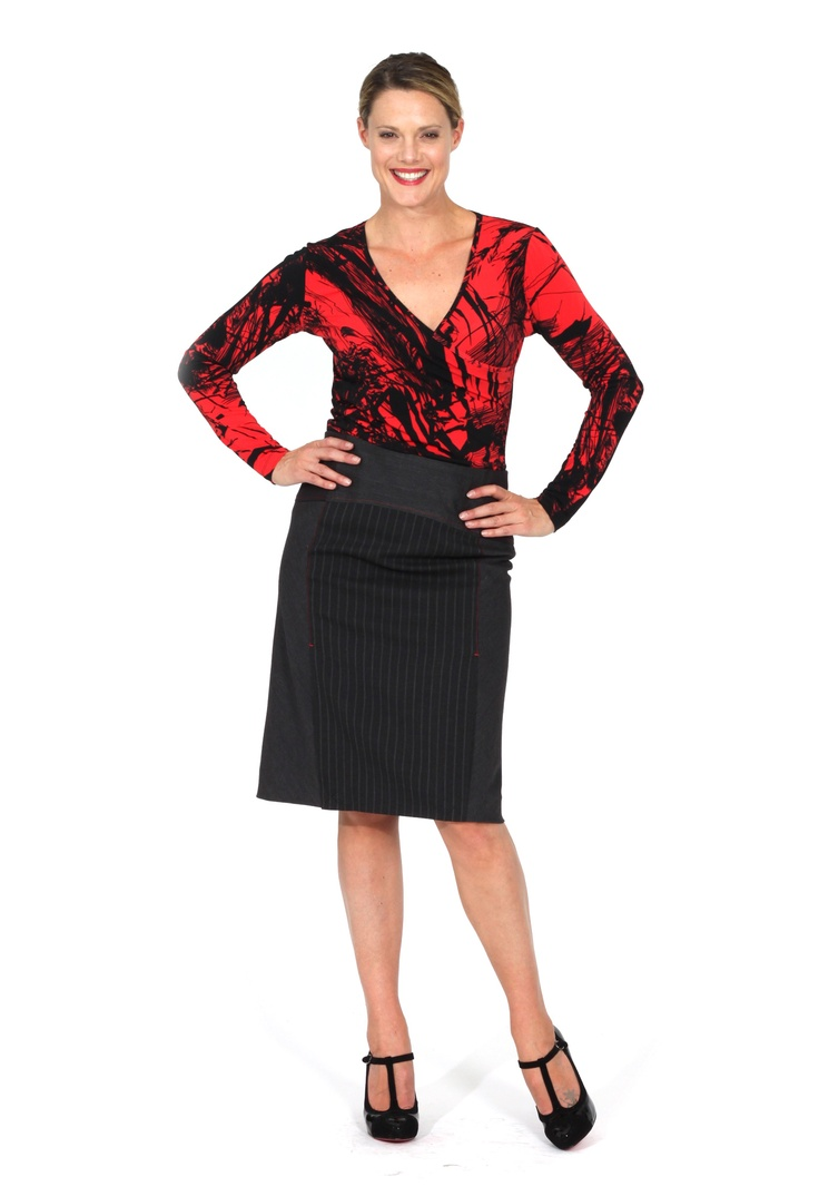 Redhead Office - Regent Street Skirt. This multi panelled skirt uses different pinstripe fabrics spliced together for a subtle yet imaginative look. The knit insets at the waist ensure a comfortable fit for this essential corporate skirt. The unique novelty lining makes the garment an extra special piece.