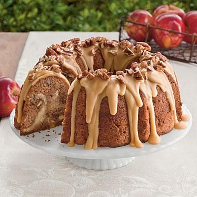 Apple-Cream Cheese Bundt Cake | This delicious apple bundt cake features a sweet cream cheese filling and homemade praline frosting. Garnish the frosting with extra toasted pecans. | SouthernLiving.com: Apple Cream Cheese, Bundt Cakes, Southern Living, Chee Bundle, Apples Desserts Recipes, Dinners Ideas, Apples Cream Chee, Cheese Bundle, Cream Cheeses