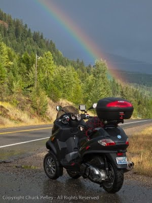 My Piaggio MP3-400 crossing British Columbia under a rainbow. In a word ... WET!