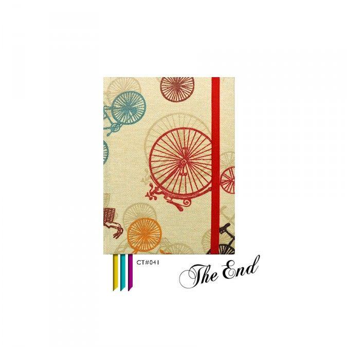 Cuaderno CT#041. Tamaño: 12 X 15 cm. Tapa dura forrada con tela estampada. 100 hojas lisas Bookcell de 80 gr. 3 Cintas señaladoras en combinación. Elástico sujetador a tono.