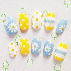 Cute spring nails with flowers and polkadots