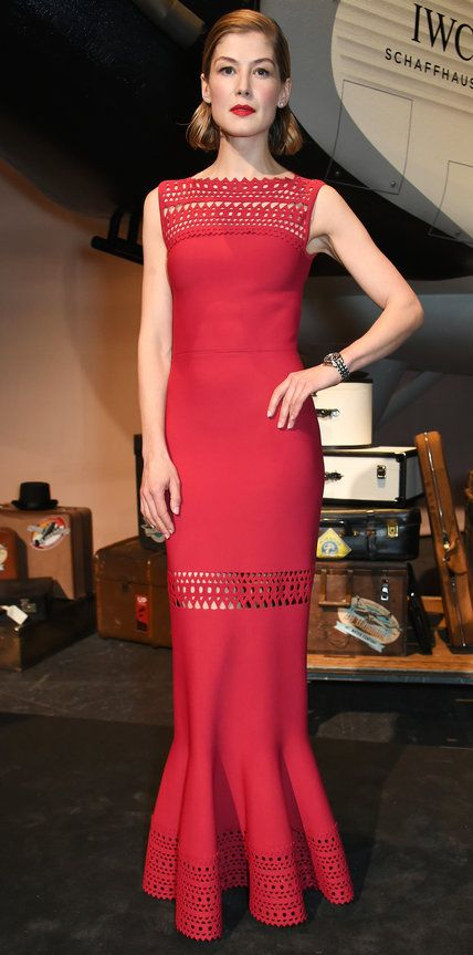 Rosamund Pike sizzled at the 2016 SIHH Gala Dinner in a sleek siren-red gown with see-through lace panels and a fluted hem.